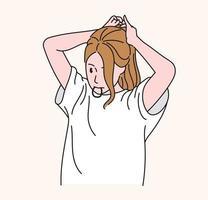een vrouw bindt haar lange haren vast. hand getrokken stijl vector ontwerp illustraties.