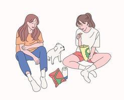twee vrienden zitten op de grond, eten snacks, kijken naar de puppy en hebben plezier. hand getrokken stijl vector ontwerp illustraties.