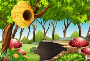 Bosscène met bijenkorf en paddestoel vector