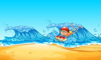 Een man geniet van bodyboarden op het strand