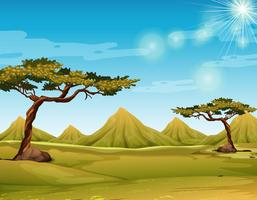 Scène met veld en heuvels