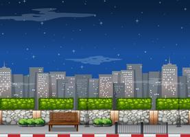 Stadsscène met lange gebouwen 's nachts