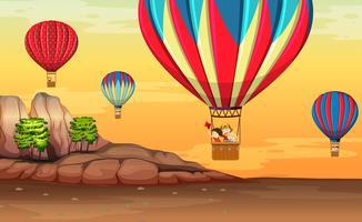 Hete luchtballon in de woestijn vector