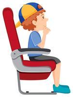 Een jongen op de vliegtuigstoel