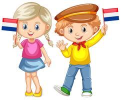 Jongen en meisje houden vlag van Nederland vector