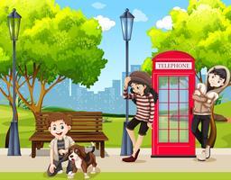 tieners en hond in park vector