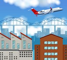 Vliegtuig vliegt boven de stad