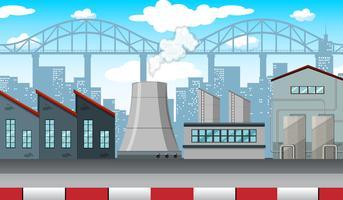 Scène met fabrieken en gebouwen langs de weg