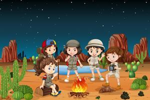 Groep kinderen die in de woestijn kamperen vector