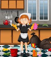 Een meid die vuile keuken schoonmaken