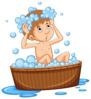 Jongen die bad in houten ton neemt