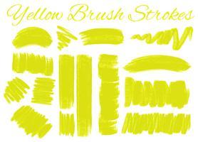 Gele penseelstreken op witte achtergrond