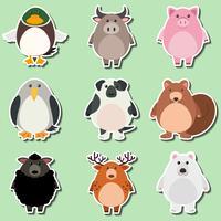 Stickerontwerp voor schattige dieren op groene achtergrond vector
