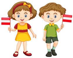 Jongen en meisje met vlag van Oostenrijk vector