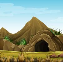 Scène met grot in de berg