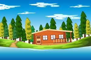 Een houten huis in het bos
