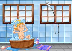 Jonge jongen die een badscène heeft