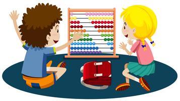 Jonge kinderen die met een telraam spelen