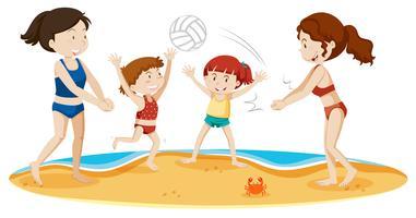 Een gezin volleyballen op het strand