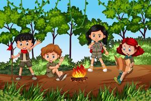 Kinderen kamperen in het bos vector