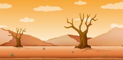 Scène met droge bomen op woestijngebied