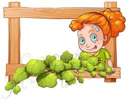 Een frame met wijnstokken en een jong meisje