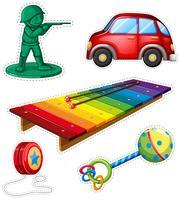 Sticker met verschillend speelgoed wordt geplaatst dat