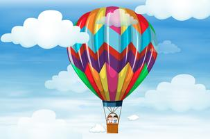 Kinderen rijden op grote ballon