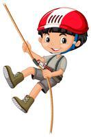 Een jongen op klimtouw