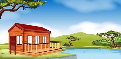 Houten huisje bij de rivier