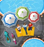 Mensen picknicken bij het zwembad