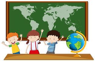 Drie studenten studeren aardrijkskunde in de klas