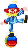 Een clown op kleurrijke bal