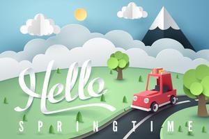 Papieren kunst van rode auto bos en berg met Hello Spring belettering