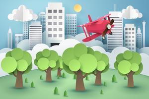 Papieren kunst van roze vliegtuig vliegt boven bos en stad, origami en duurzaam