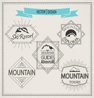 berg en emblemen vector