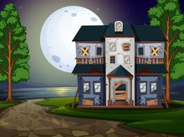 Spookhuis bij het meer 's nachts