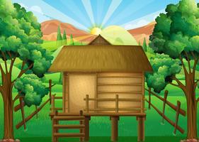 Houten hut in het bos