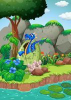 Blauwdraak uitbroedend ei door de rivier