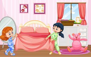 Meisjes in pyjama's maken bed vector