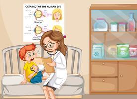 Een zieke jongen met dokter