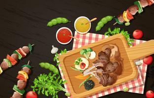 Gegrilde lamskoteletjes en barbecue op houten plank vector