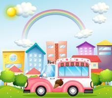 Een roze ijsjesbus in de stad