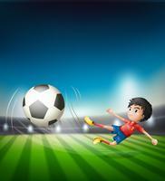 Een voetbalspeler die bal schoppen