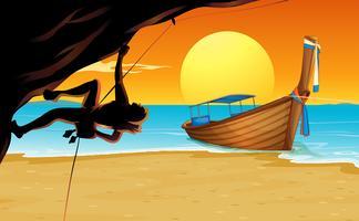 Scène met bergbeklimmer en strand