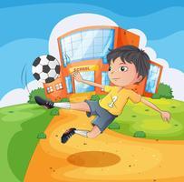 Een voetbalspeler voor het schoolgebouw