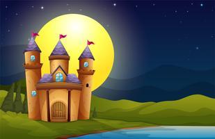 Een kasteel in een landschap van de volle maan