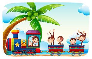 Apen zittend aan een trein aan strandzijde