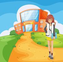 Een dame die buiten het schoolgebouw staat