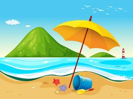 Strandscène met paraplu en speelgoed